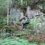 Dan climbing up a rock face