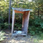 Derelict hunt camp outhouse