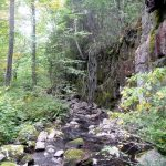 Steep rock wall along creek